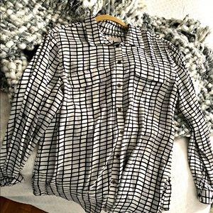 Oversized black and white patterned blouse
